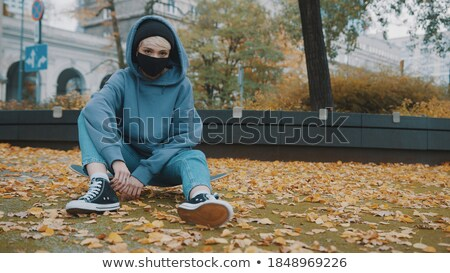 Bored young blonde sports woman in park outdoors. Stock photo © deandrobot