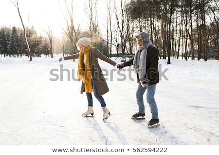 couple in sunny winter nature ice skating Stock photo © Lopolo