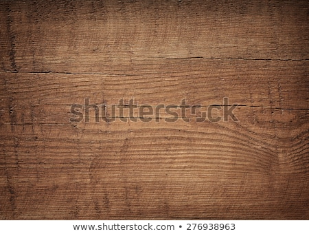 Wood texture. Dark brown scratched wooden cutting board. Stock photo © ivo_13