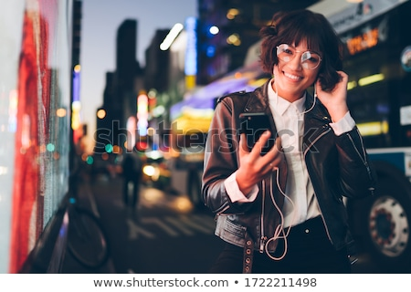 Modern girl choosing audio on gadget Stock photo © pressmaster