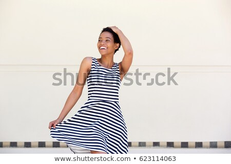 Afro girl in striped dress Stock photo © nyul