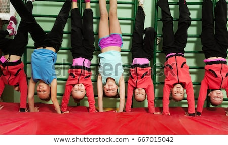 Happy children making sport. Group of happy boys making sports h Stock photo © matimix