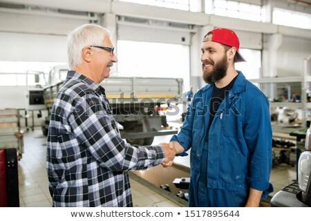 Boldog fiatal szakállas szerelő karbantartás szolgáltatás Stock fotó © pressmaster