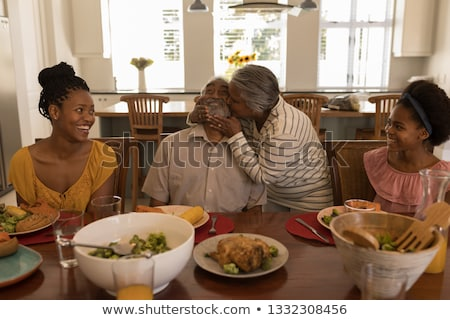Front view of a happy African American grandmother and granddaughter reading a story book in living  Stock photo © wavebreak_media