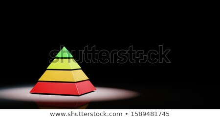 Four Levels Pyramid Spotlighted on Black Background Stock photo © make