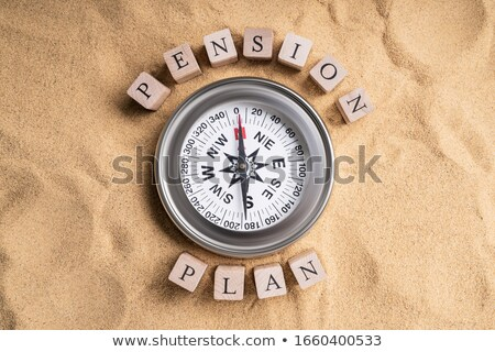 Pension Plan Compass On Sand Stock photo © AndreyPopov