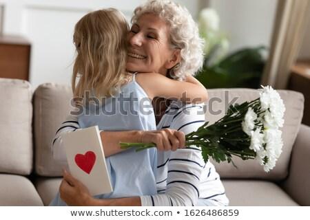 Gelukkig senior vrouw bloemen wenskaart vakantie Stockfoto © dolgachov