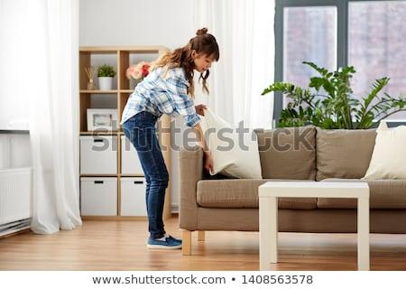 asian woman arranging sofa cushions at home Stock photo © dolgachov