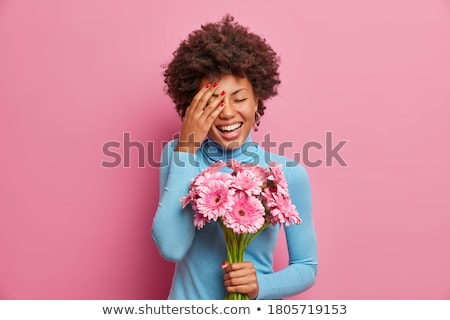 Overjoyed Afro American woman laughs positively, keeps hands on chest, hears hilarious joke, express Stock photo © vkstudio