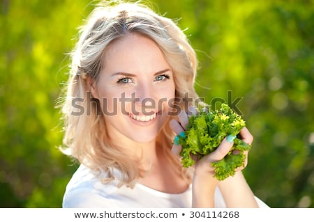 Blonde Woman Holding Salad Lettuce over Face Stock photo © Amosnet