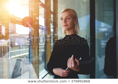 beautiful business woman thinking about something while working stock photo © hasloo