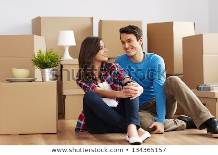 Woman sitting crossed legs on floor of new home Stock photo © photography33