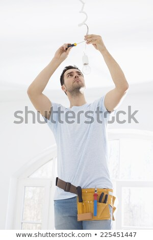 Man repairing ceiling light with screwdriver Stock photo © photography33