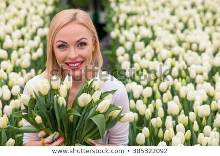 feliz · jovem · mulher · tulipas - foto stock © dolgachov
