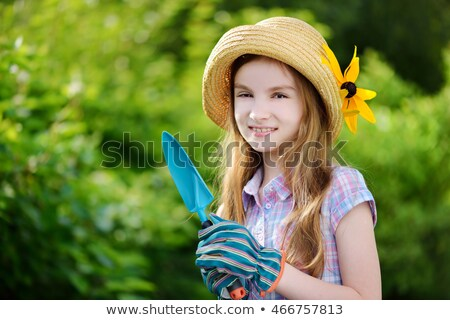 Little girl wearing straw hat holding plant pot Stock photo © photography33