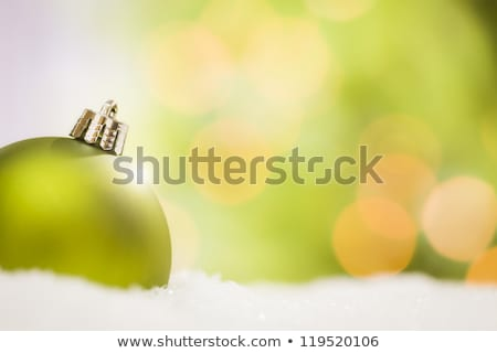 Green Christmas Ornaments on Snow Flakes with Text Room Stock photo © feverpitch