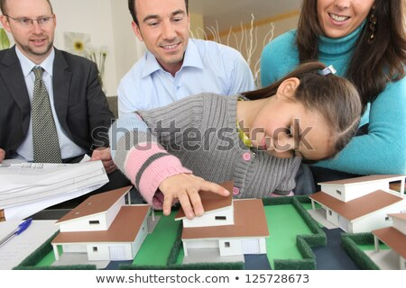Couple and realtor watching model Stock photo © photography33