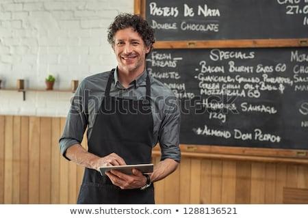 Middle-aged waiter holding menu Stock photo © photography33