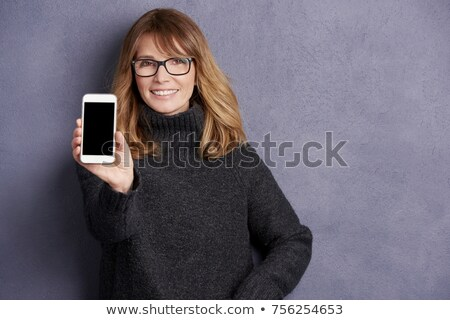 Beautiful woman showing a copy space while standing against a white background stock photo © wavebreak_media