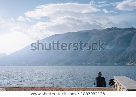 Man spelevaren meer hemel gelukkig boot Stockfoto © dacasdo