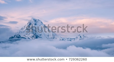 Panorama of evening mountains in clouds Stock photo © BSANI