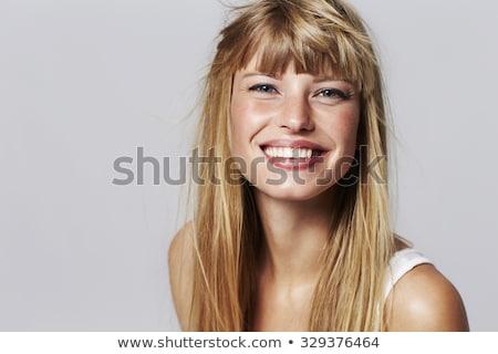 笑みを浮かべて ブロンド 女性 青い目 肖像 黒 ストックフォト © aladin66
