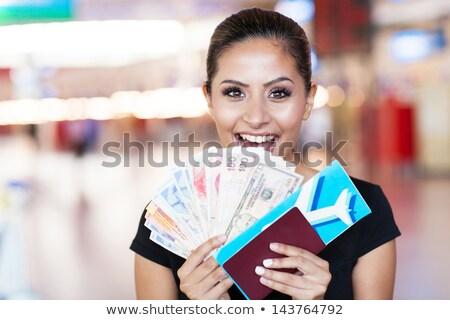 nő · tart · valuta · jegyzetek · női · igazgató - stock fotó © stockyimages