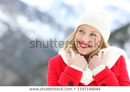 Fiatal nő meleg ruha gondolkodik fiatal felnőtt kaukázusi nő Stock fotó © bmonteny