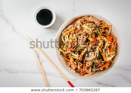 Fast meal with fried rice noodles topped pork  Stock photo © nalinratphi