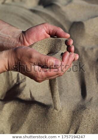 Sand through fingers Stock photo © mikhail_ulyannik