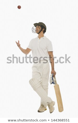 Man tossing a ball with a cricket bat Stock photo © imagedb