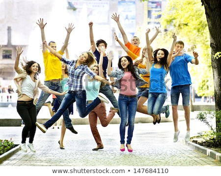 grupo · sorridente · mulheres · jovens · saltando · ar · felicidade - foto stock © zurijeta