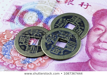 Chinese coins and bills Stock photo © Hofmeester