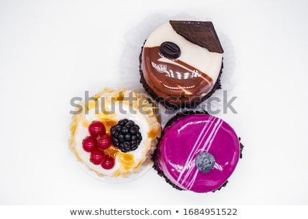 Mini cakes with white chocolate glaze Stock photo © Digifoodstock