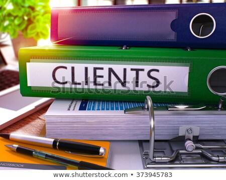Zöld iroda mappa felirat ügyfelek asztali Stock fotó © tashatuvango