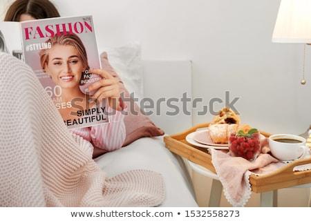 женщину расслабляющая чтение журнала кровать весело Сток-фото © IS2