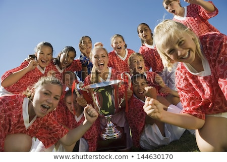 Girl cheering with trophy outdoors Stock photo © IS2