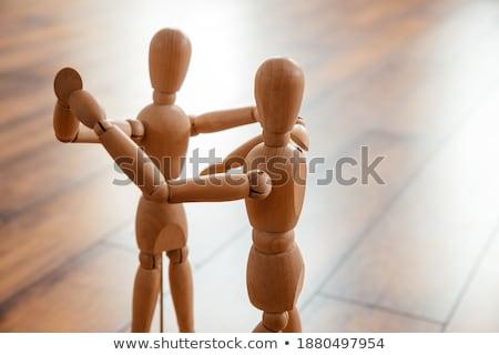 Wooden figurine exercising on floor Stock photo © wavebreak_media