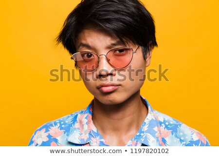 83d562d6dcb Close up portrait of a doubting asian man in sunglasses Stock photo ©  deandrobot