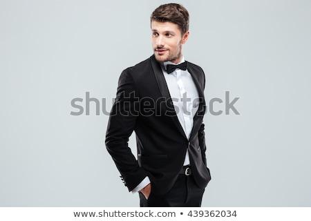 Portret jonge bruidegom zwarte smoking permanente Stockfoto © feedough