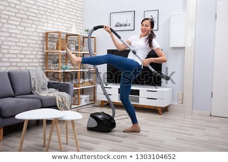 feliz · mulher · aspirador · de · pó · casa · pessoas · trabalhos · domésticos - foto stock © andreypopov