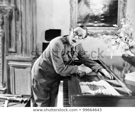 Well dressed man adjusting his eye-glasses Stock photo © feedough