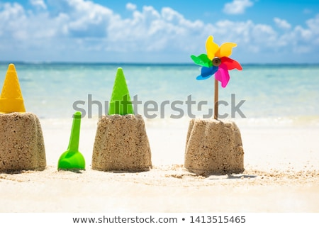 Toys And Pinwheel In Front Of Sea At Beach Stock photo © AndreyPopov