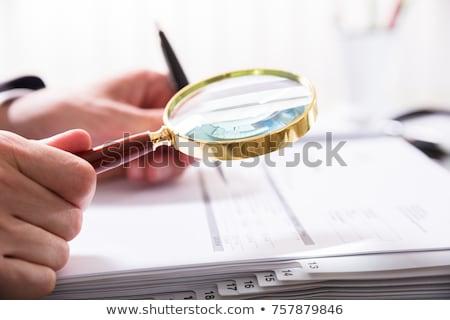 Ragioniere lente di ingrandimento bill primo piano commercialisti Foto d'archivio © AndreyPopov