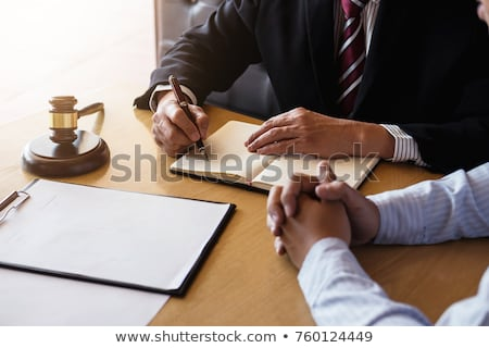 Close up of gavel, Male lawyer or judge working with Law books,  Stock photo © Freedomz
