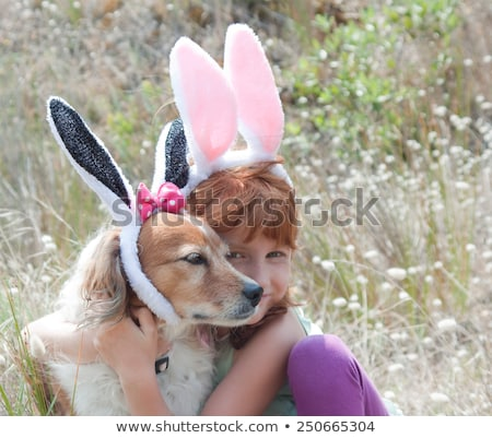 Stock photo: happy red haired girl wearing easter bunny ears