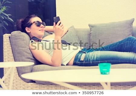bella · ragazza · messaggio · smartphone · spiaggia · internet · donna - foto d'archivio © dacasdo