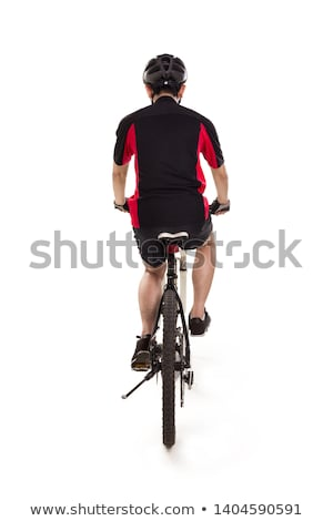 Jovem asiático homem equitação exercer bicicleta Foto stock © Qingwa