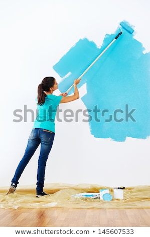 attractive woman painting a wall stock photo © photography33