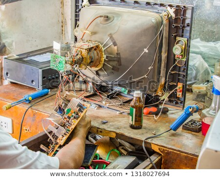 Man fixing an old television Stock photo © photography33